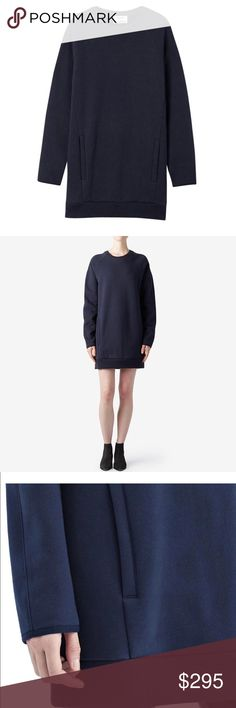 Acne Studios Navy Oversized Sweatshirt Dress Acne Studios navy blue sweater dress in size extra small. A cozy sweatshirt dress in soft fleece. Welt front pockets. Ribbed crew neckline. Long sleeves with tonal piping at the cuffs. Unlined.    Fabric: Fleece.  80% cotton/20% polyester.  Dry clean or wash cold.  Made in Portugal.  Blue Navy Oversized Sweater Sweatshirt Modern Minimalist Chic Structured Dress Acne Dresses Mini