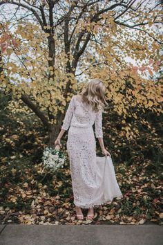 floral long sleeve lace wedding dress by Jennifer Gifford