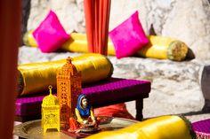 village theme mehendi , lanterns , village woman miniature figurine , orange and yellow and pink theme