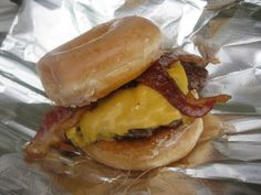 The paula deen big e crazyBurger is a Bacon Cheeseburger with grilled Krispy Kreme Doughnuts as its buns. Paula Deen has served it at her restaurant in Savannah, Georgia and it's rumored to be named after singer ...