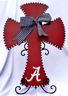 "University of Alabama decorative wooden cross.  Houndstooth ribbon.  22"" tall by 15 3/4"" wide.. $55.00, via Etsy."