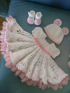 Pink and white crochet baby outfit with roses and lace