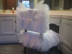 This is my Fairy Princess Chair Suit®, shown here in white and made in standard chair size.  The wings detach to wear for play time.  Both the jacket and skirt are trimmed in multiple layers of shirred sparkle tulle.  Sparkle ribbon ties attach the jacket and skirt to the chair.  Both jacket and skirt are lined.  This Chair Suit® is always a favorite!  Each set is made to custom fit your chair.  Dry clean only.