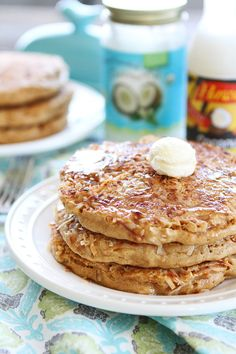 Toasted Coconut Pancakes Recipe on twopeasandtheirpod.com Light and fluffy pancakes with a sweet toasted coconut topping!
