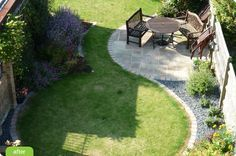 Small garden design - love the softness of the curvy grass and patio areas