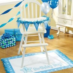 Decorated highchair for 1st birthday.  See more first boy birthday and party ideas at one-stop-party-ideas.com