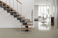 This staircase is made to order in Italy and delivered direct to you for easy installation.  What an inspiring project!  This is the Genius 040 RA modular staircase available from http://www.staircasekits.co.uk/acatalog/Made_to_Order_Staircases.html and you will see more of these staircases plus their range of made to order spiral staircases on their website.