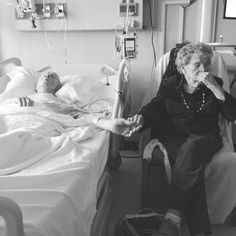 "If there's a photo out there that more beautifully captures enduring love, we're not sure we've seen it. The photographer and grandson of the couple wrote of the photo, ""My 91-year-old grandfather is dying. Caught this beautiful moment between he and my 92-year-old grandmother in the hospital today."" 10-30-2013 HuffPost"