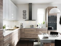 We Love: Contrast in the Kitchen Ikea Kitchen, modern brown and white. I would do the Adel white on top, the shaker style.Ikea Kitchen, modern brown and white. I would do the Adel white on top, the shaker style. Kitchen Interior, New Kitchen, Kitchen Decor, Walnut Kitchen, Gloss Kitchen, Kitchen Wood, Apartment Kitchen, Kitchen Dining, Dining Room