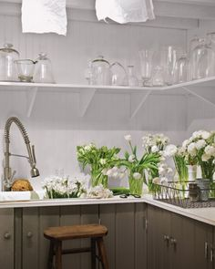 FANTASTIC sink for the laundry room/storage space/butler's pantry:  a double sink that's 12 inches deep and paired with a gooseneck faucet and pullout hose with spray attachment. Exactly what I was thinking, Martha Stewart.