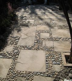 I like this though I'm not sure how much work it would be.... Pebble texture keeps it from looking too plain, probably would help the pathway not be too slick when wet.  MetaMosaics