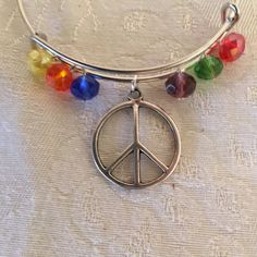 Peace Sign Charm And Crystal Adjustable Wire Bangle Bracelet Silver Tone by cbfcreationsHB on Etsy