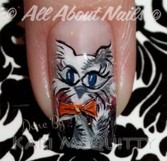 Cute hand painted kitty added to sculpted gel nails done at www.allaboutnails.org.