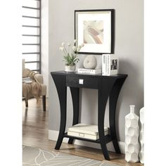 Add a stylish touch to your entryway or any interior space with this console table. A two-tiered design and black finish highlight this modern design.