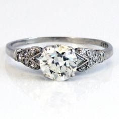 A classic all original Edwardian platinum beauty, c. 1915... set with a perfectly clean and perfectly white European cut, 10 old single cut diamonds, and what make me the most excited-- two triangle shape diamonds darting out on either side. $6,200