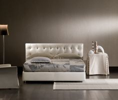 """Classical and traditional lines characterize this bed, the headboard of which is decorated with a geometrical capitonné design with decorative buttons in leather, dipped gold or transparent. [Double Bed """"Relais"""" Design Rodolfo Dordoni for Flou] #Beds #Bedroom #Letto #InteriorDesign #HomeDecor #Design #Arredamento #Furnishings"""