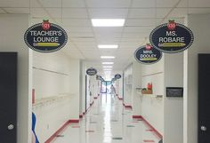 Wow! What an AWESOME transformation!  Your RoomTagz hallway signs look great.  The principal admitted he was reluctant to purchase the double-sided hallway signs at the suggestion of a few teachers who saw them on Pintetest, but enthusiastically relieved he did because of the difference they make.  Each sign is approximately $50 and includes sign, all the vinyl lettering needed to personalize, and hanging hardware.  The lettering is easily removable & replacable when a change in staff…
