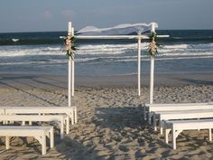 Bamboo poles are ideal for destination weddings because they're easy to assemble and complement (rather than overshadow) the natural beauty of the ceremony site.