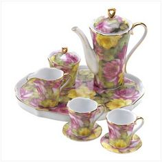 Set an elegant tea time table with these charming miniature collectibles! Elegant ensemble features a full array of serving pieces and matching tray in a lovely English Rose motif. Decorative purposes only. Set is 7 Childrens Tea Sets, Mini Roses, Teapots And Cups, Chocolate Pots, Coffee Set, High Tea, T 4, Tea Time, Tea Party
