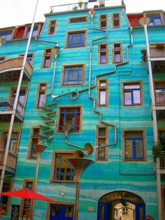 The Neustadt Kunsthofpassage, if I understand my sources correctly, is an artsy neighborhood in Dresden. One wall of a building there is covered with funnels and gutters shaped like musical instruments. It's like a Rube Goldberg machine with water.