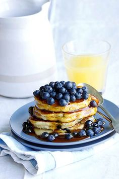 The ultimate weekend breakfast treat. A stack of ricotta pancakes served with a pile of fresh blueberries and a good drizzle of syrup.  #recipe #vegetarian