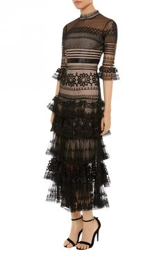 Crafted from sheer and dotty tulle, the Midi Pirate Sleeved Dress takes the house's bohemian DNA and infuses it with the season's pirate-inspired mood. In a sheath silhouette with a mock neck and beautifully tiered ruffles, this black evening dress is immaculately finished with ribbon appliqué and corded embroidery.
