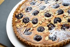 The classic combination of cherries and almonds is irresistible. For this tart, whole pitted cherries are baked in a rich almond batter called frangipane. Softly whipped cream, crème fraîche or vanilla ice cream make nice accompaniments. (Photo: Karsten Moran for The New York Times)