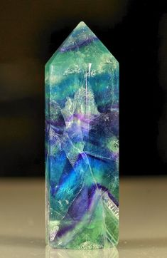 Fluorite. Blue Fluorite enhances creativity, orderly thought and clear communication. Purple Fluorite stimulates the third eye, imparts common sense to psychic communication. Green Fluorite grounds excess energy, and brings information up from the subconscious mind and accesses intuition. ~ This one looks like has a little bit of each in it! (Want!)