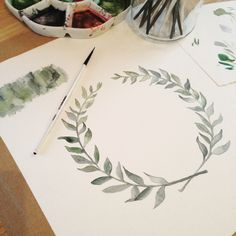 Watercolor in progress - painting customised leaf wreath for wedding invitation suite