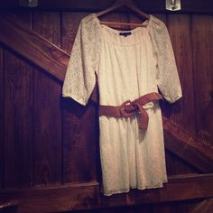 Lace white summer Dress! Lacy white summer dress. A slip is connected underneath. Arms are see through. Stretchy, adjustable brown belt included. Looks awesome with wedges and cowboy boots. HeartSoul Dresses