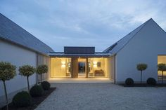 New build house in Co. Carlow, completed The H plan form, making two open courtyards, maximises light and views while placing the double height hallway at the heart of the house. The form of buildings echoes low eaved and grounded. Bungalow Extensions, House Extensions, Modern Barn House, Modern House Design, Barn House Plans, House Designs Ireland, Cottage Extension, House Extension Ireland, Bungalow Renovation