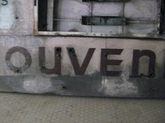 A section of the word souvenirs, abandoned Oakland, 16th St train station, April, 2015