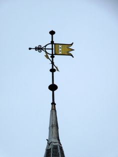 This #weathercock with the three Andreas crosses, the symbol of #Amsterdam, is on top of the police office #Raampoort (meaning window in the city gate). Originally on this location there was a little city gate, in 1888 the police office was built.