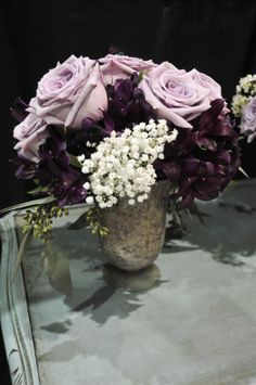 purple and gold  and eggplant wedding centerpiece by flowershackblooms.com