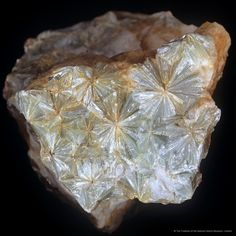 Pyrophyllite (aluminium silicate hydroxide) has distinct fan shaped radiating crystals