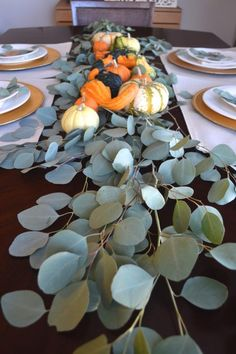 Thankgsiving tablescape with eucalyptus leaves, eucalyptus and pumpkin thanksgiving centerpiece, thanksgiving pumpkin table centerpiece Eucalyptus Centerpiece, Flower Centerpieces, Table Centerpieces, Thanksgiving Flowers, Thanksgiving Centerpieces, Thanksgiving Ideas, Seasonal Decor, Fall Decor, Holiday Decor