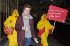 Coffee brand Kenco ambushed new Radio 1 breakfast presenter Nick Grimshaw this morning as he made his way to work for his first shift; two roosters presenting him with a year's supply of coffee carrying a board saying'Time to wake up and smell the coffee, Nick'.