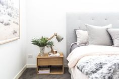 Gorgeous, soft and romantic bedroom featuring grey upholstered bed head, low timber side tables, The Artwork Stylist 'Pink Desert' artwork and luxury bedding. It's the bedroom of stylist Aimee Tarulli and you can see more of her home on the blog now...