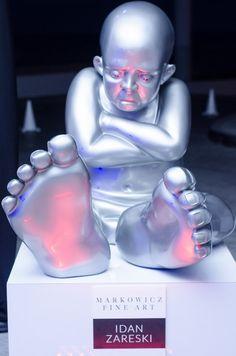 Silver Babyfoot at Luxury Lifestyle Showcase at Jade Ocean with Markowicz Fine Art. Resin Sculpture by Idan Zareski
