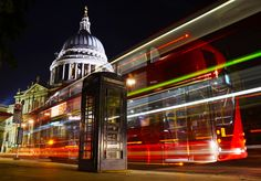 Light trails of a new Routemaster bus at St. Paul's Cathedral in London.