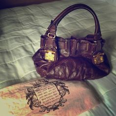 Juicy couture handbag Plum colored leather handbag still in excellent condition. By far one of my favorite pieces. Juicy Couture Bags