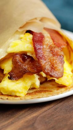 Eggs, bacon and a hash brown, all slathered in maple butter and warmly hugged in a thin pancake wrap.
