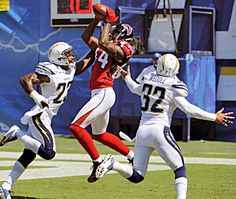 Score: 27/3    Falcons receiver Roddy snags a pass between Chargers Quentin Jammer (left) and Eric Weddle during Atlanta's win.