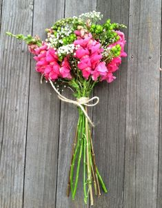 This vibrant bouquet features snapdragons and is accented with a little bit of hypericum and baby's breath as filler. This would be a great DIY option for the budget conscious bride - snapdragons, baby's breath, and hypericum are all very budget friendly! Shop these and other popular wedding flowers online at GrowersBox.com!