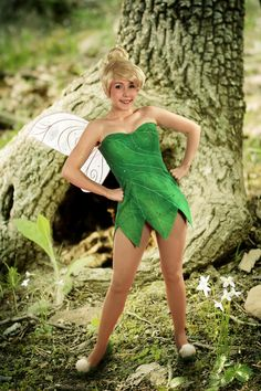 Tinkerbell - I was her for Halloween one year in elementary school, but I'd love to dress up as her again someday! :)
