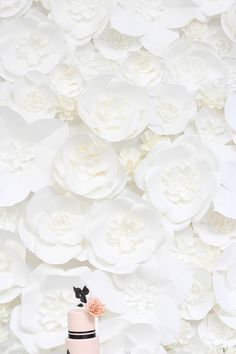 White Paper Flower Wall / Photography: Laura Clarke Photography, Paper Flower Wall: Drangonfly Expression via Style Me Pretty