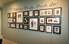 Nice family photo display with vinyl word art.