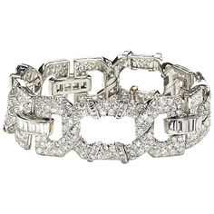 Cartier Art Deco diamond platinum bracelet   From a unique collection of vintage link bracelets at https://www.1stdibs.com/jewelry/bracelets/link-bracelets/