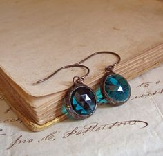 Hey, I found this really awesome Etsy listing at https://www.etsy.com/listing/183144267/teal-round-faceted-glass-earrings