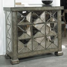 wonderful antiqued mirror chest of drawers.